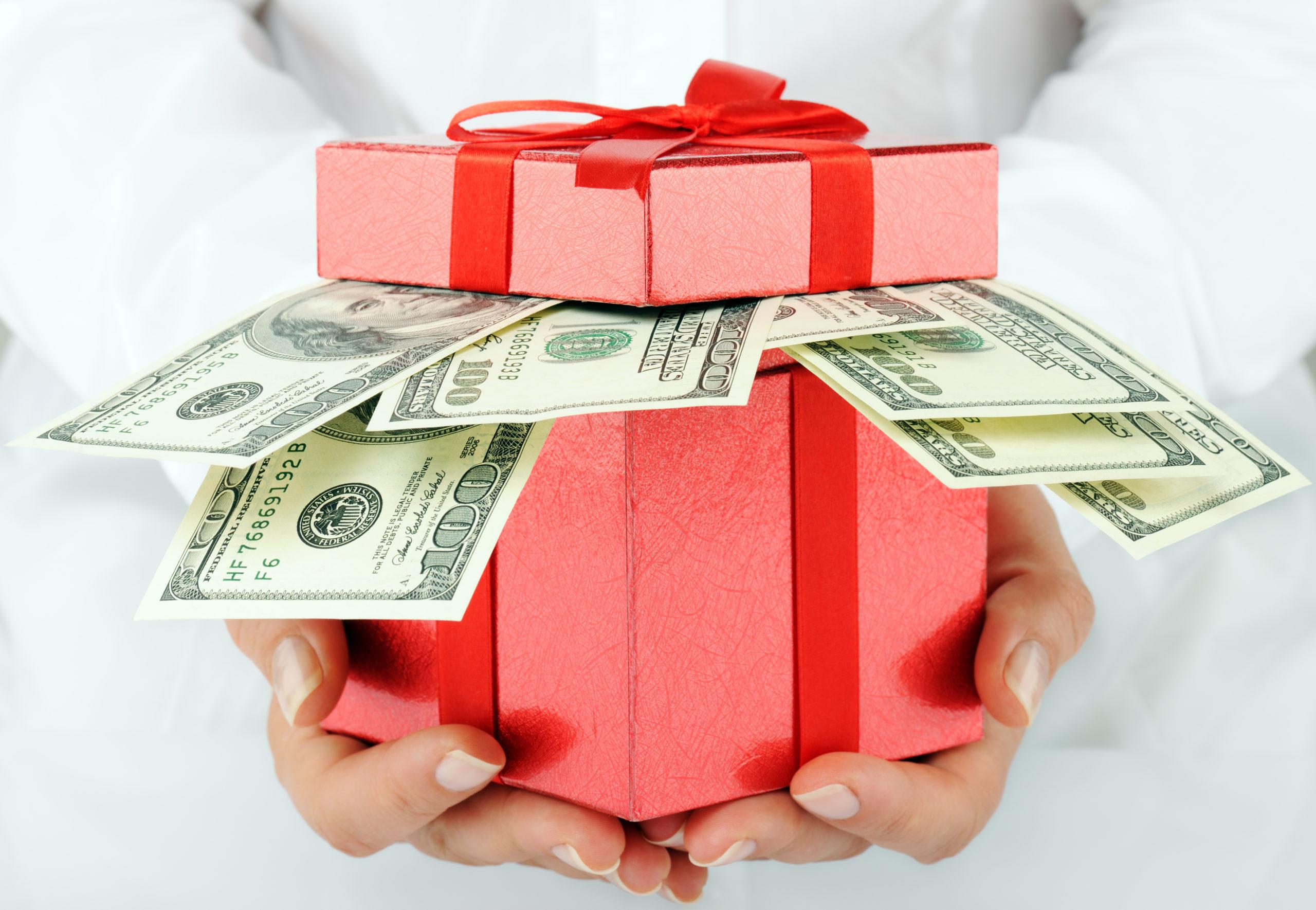 Red box gift containing 100 dollar bills
