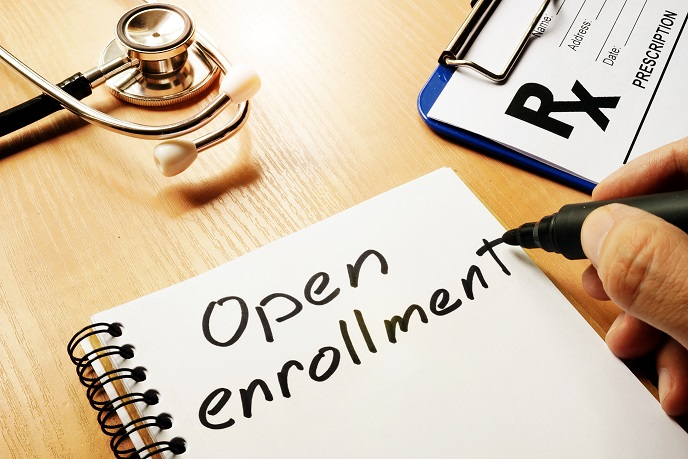 Open Enrollment written in a notebook