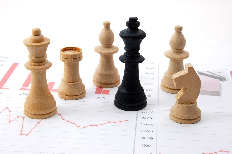 chess pieces on a financial document
