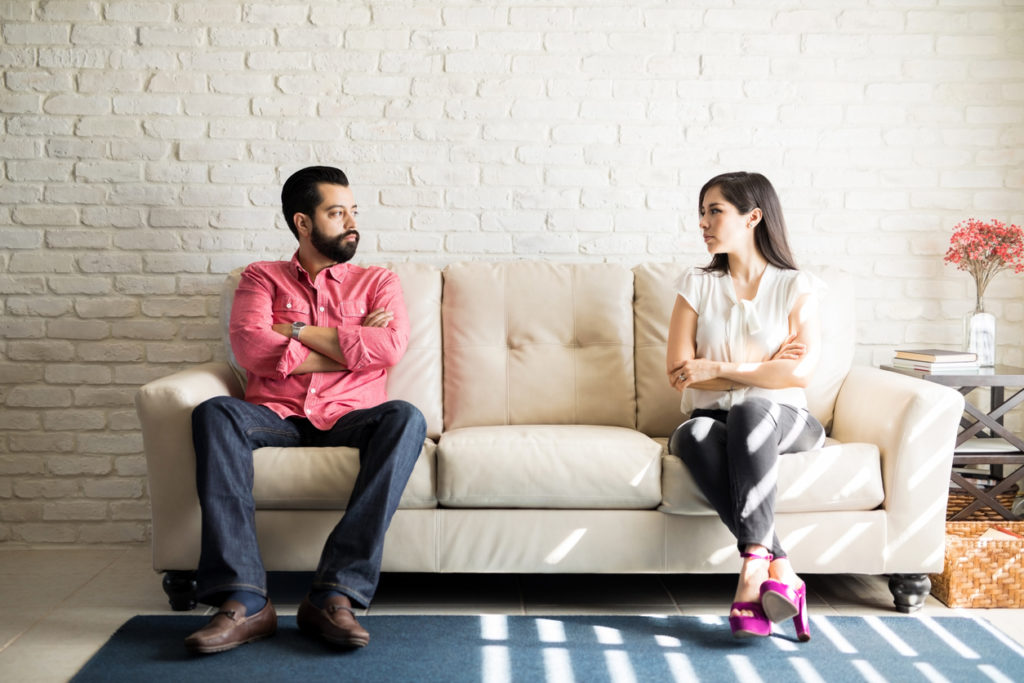 Disputed couple staring at each other with anger