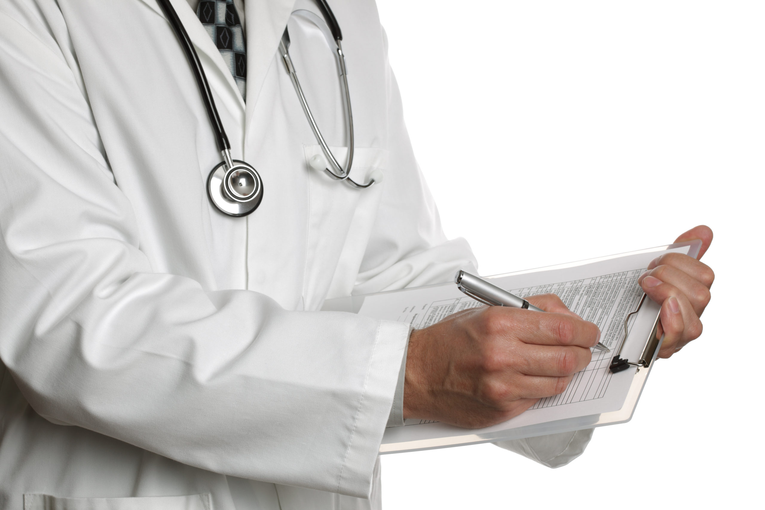 Doctor writing in a form over a clipboard
