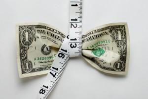 Belt tightening a dollar bill
