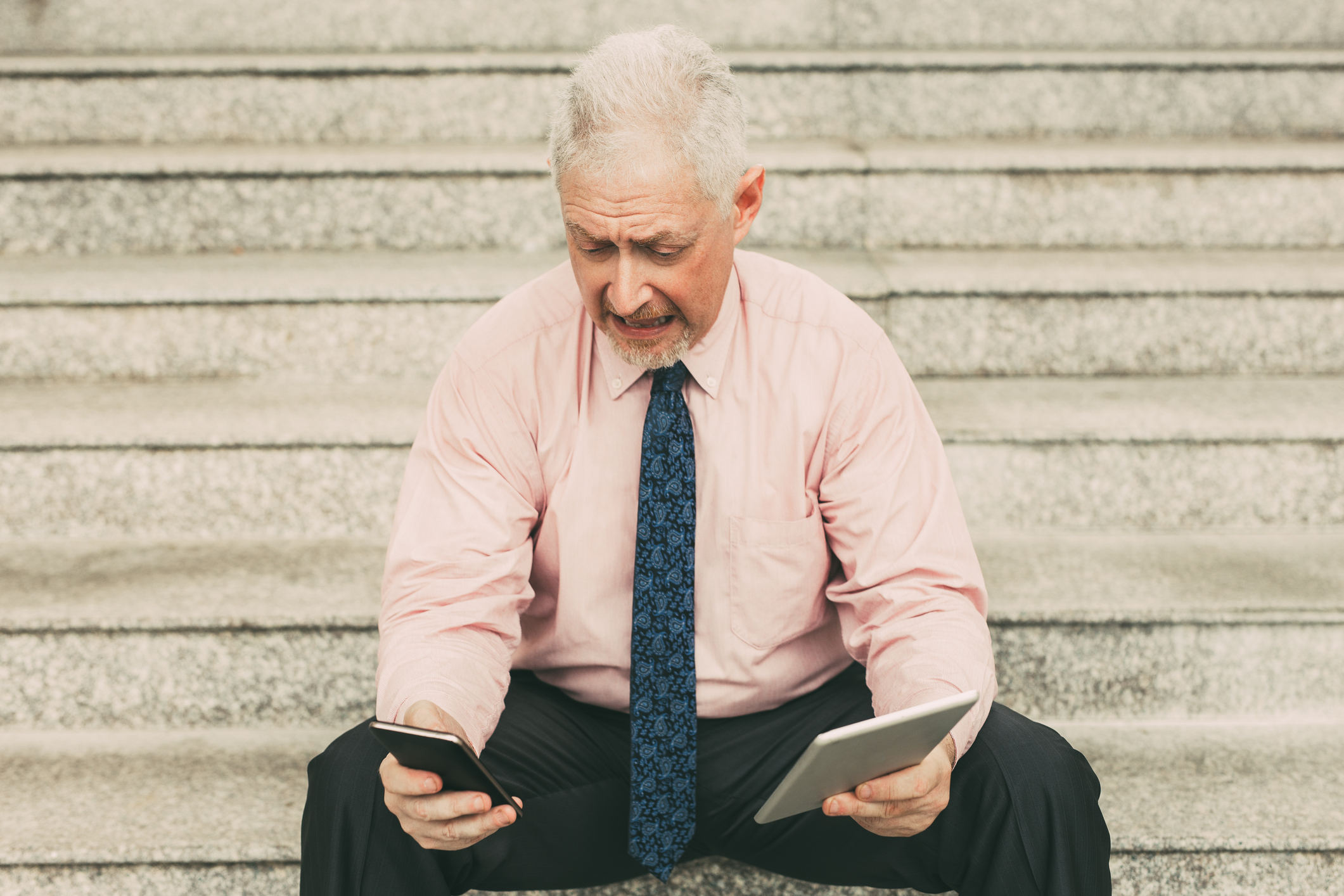 Worried Business Man with Tablet and Smartphone