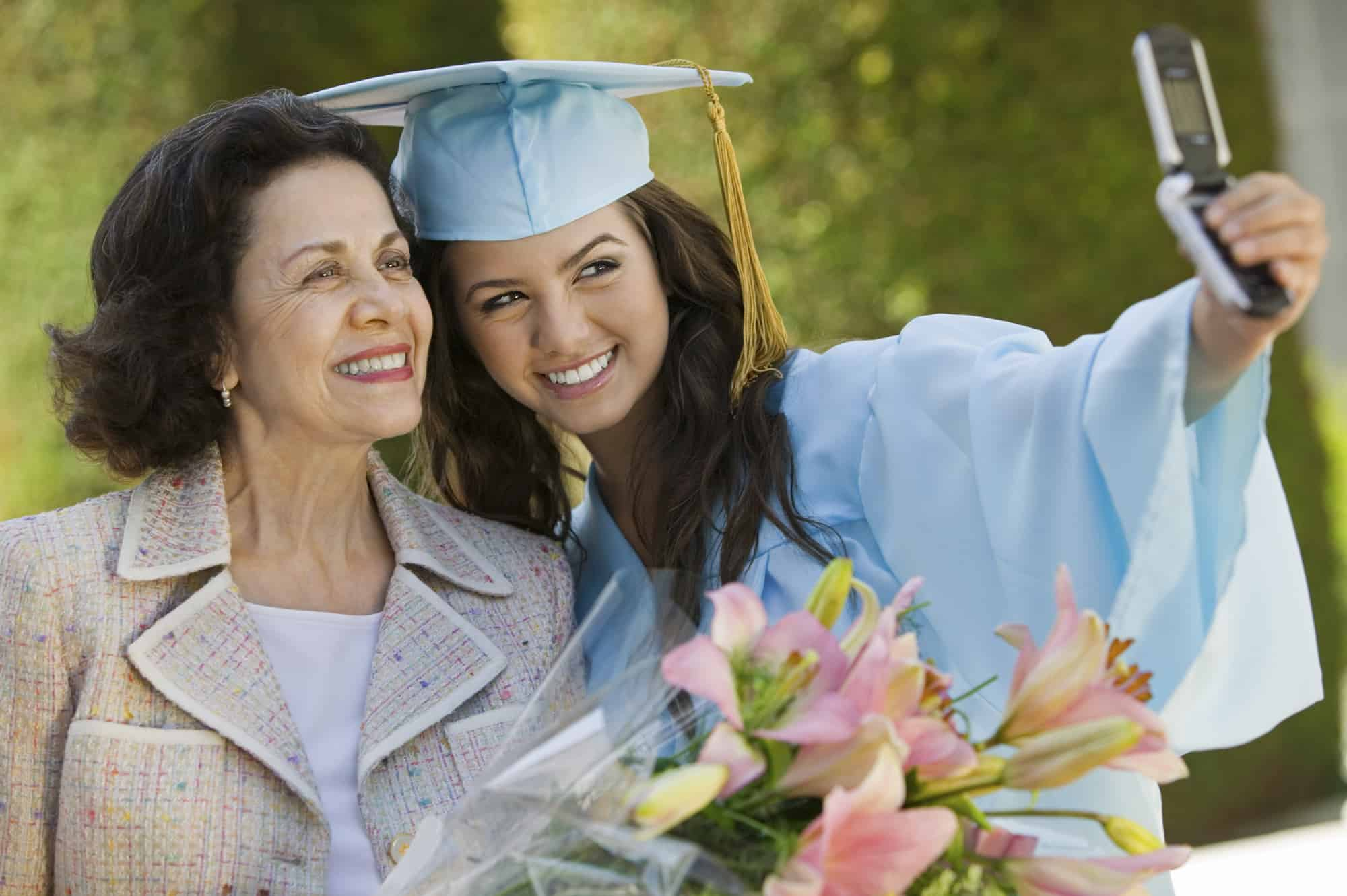 Graduate girl taking a selfie with Grandmother