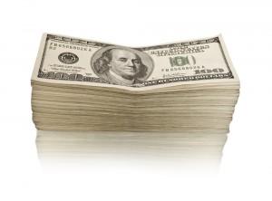 One-Hundred Dollar Bills piled up