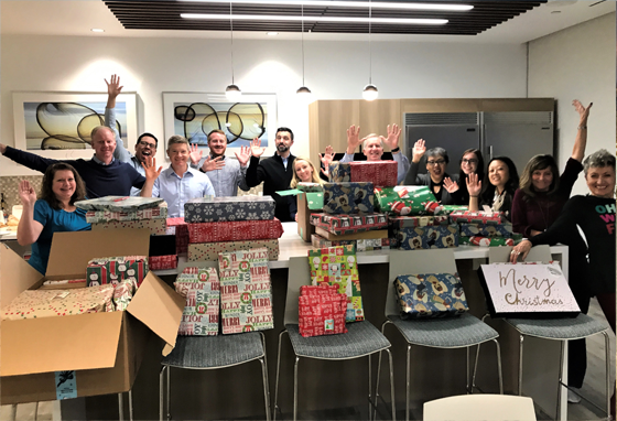 D&Y Employees Wrapping gifts for families in need