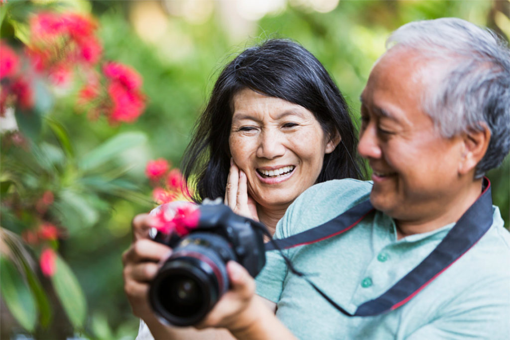Couple enjoying photography in the nature