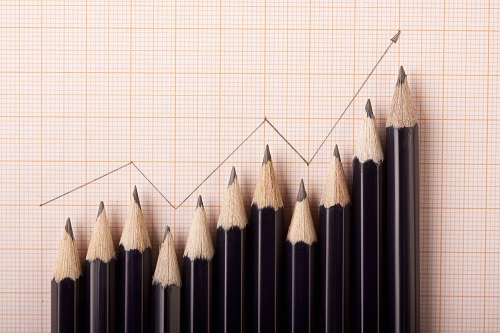 chart line made with pencils showing gradual increase